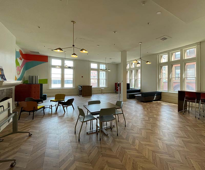 Large room with chairs and desks